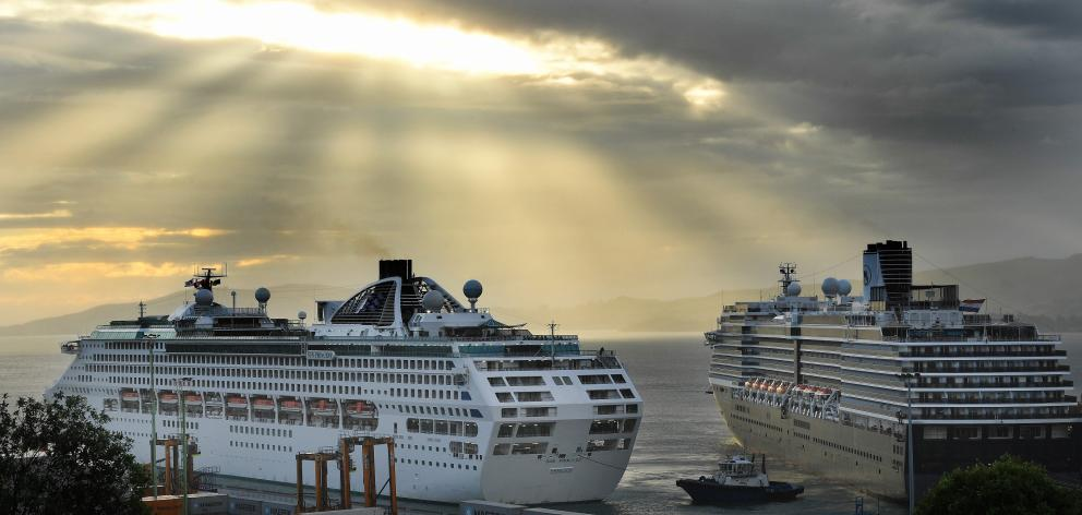 Sun Princess (left) and Noordam dock at Port Chalmers on the last day of the cruise ship season....