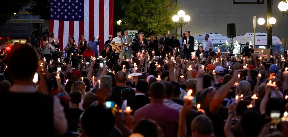 Local and state politicians and business leaders join community members for a vigil at the scene of a mass shooting in Dayton. Photo: Reuters