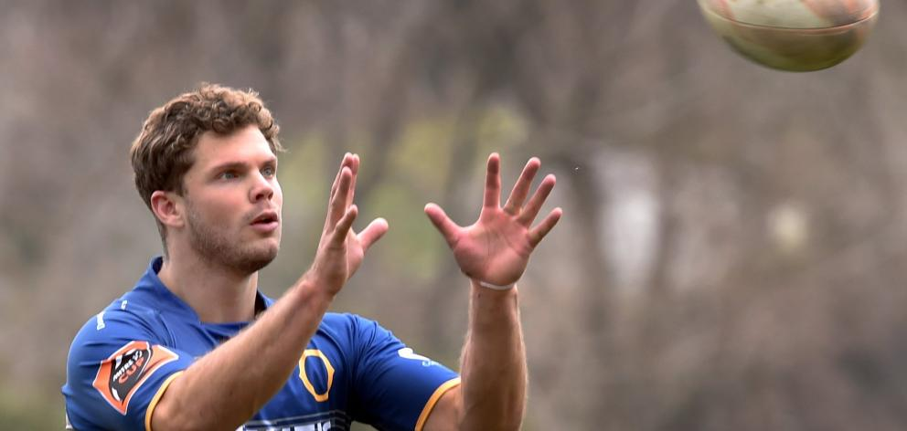 New Otago winger Henry Purdy is about to take a pass at Otago training at Logan Park earlier this week. Photo:  Peter McIntosh