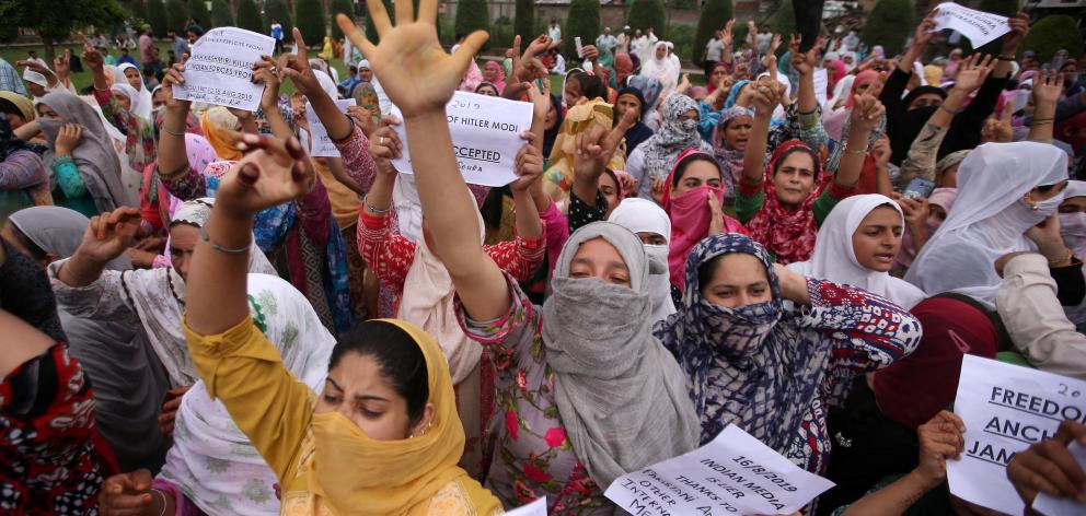 Kashmiri women shout slogans at a protest in Srinagar. Photo: Reuters