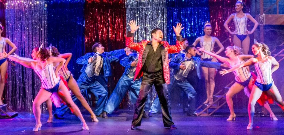 Marcus Rivera playing the demanding role of The Engineer in the Packemin Production of Miss Saigon in 2017. Photo: Supplied