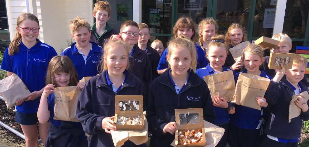 Weston School pupils with their lunches from Oamaru restaurant Midori, which now arrive in...