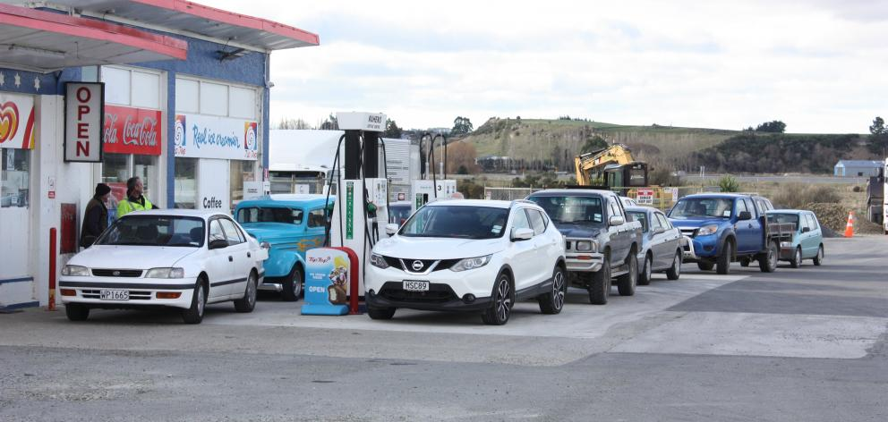 Vehicles line up at the Maheno service station to take advantage of cheap fuel yesterday. Photo: Gus Patterson