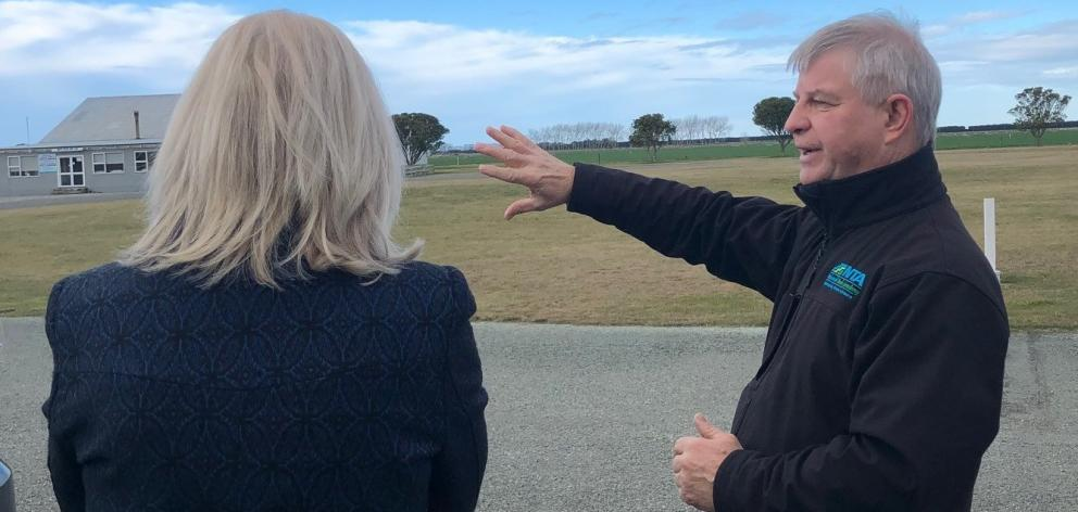 National Trade Academy managing director Craig Musson explains plans for a new dairy farm school at Oamaru Airport to Waitaki MP Jacqui Dean. Photo: Supplied