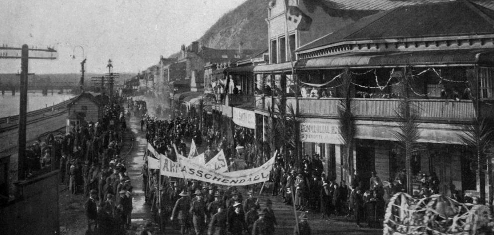 The peace procession in Greymouth passes along Mawhera Quay. - Otago Witness, 6.8.1919.