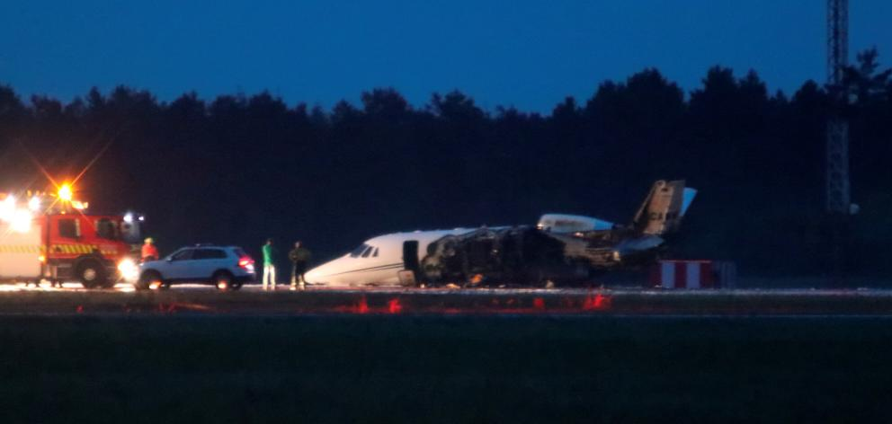 A private Cessna 560XL aircraft is seen after crashing while landing at Aarhus Airport in Tirstrup. Photo: OEXENHOLT FOTO/Ritzau Scanpix via Reuters