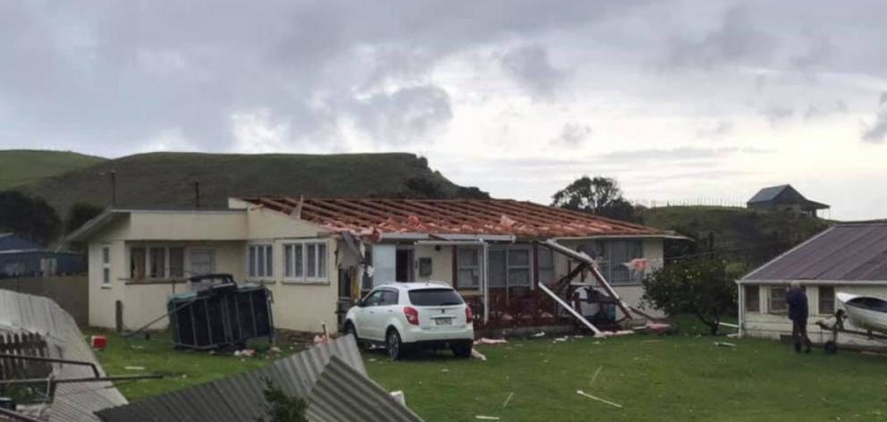 Roofs were ripped from three beach houses in Awakino by a twister. Photo: Deane Riddick Facebook