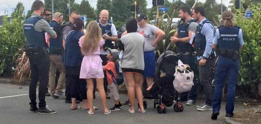 The infamous travellers talk to Police and Immigration officers in Hamilton. Photo: NZ Herald