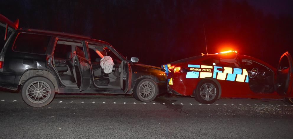 Police say the man crashed his car into a patrol vehicle, then approached an officer in a...