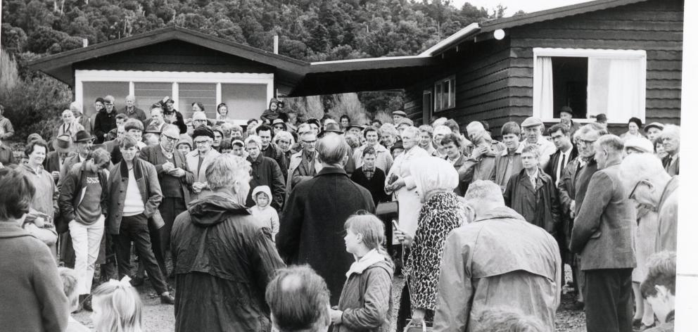Forest & Bird Otago branch chairman Wallace Ramsay (centre) addresses the crowd at the opening of...
