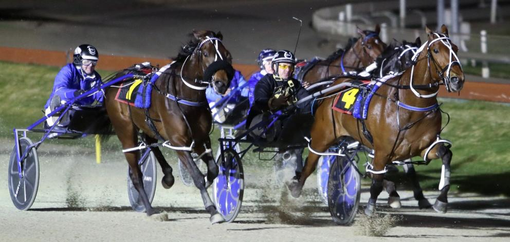 Chase Auckland and driver Tim Williams (inner) hold out Spankem and Mark Purdon to win the New...
