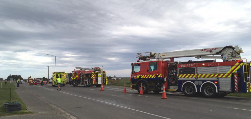 Emergency services at the scene of a crash involving a car and truck on the Bluff Highway. Photo: Laura Smith