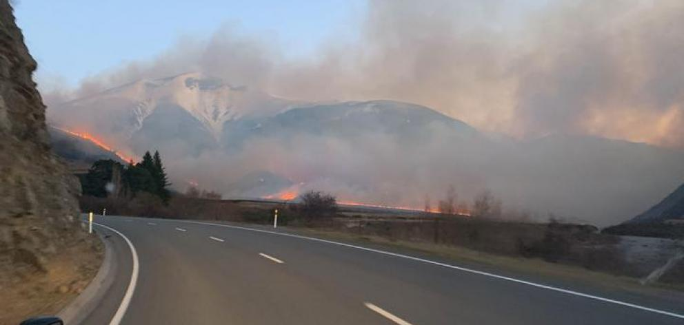 An image of the fire taken from inside a blocked off part of SH73. Photo: Supplied Darryl McCabe via RNZ