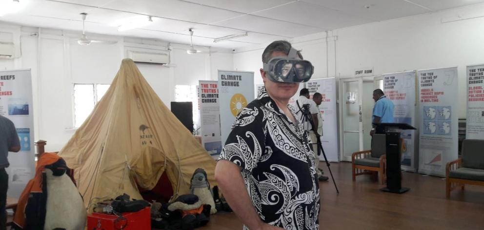 New Zealand's High Commissioner to Fiji, Jonathan Curr, uses a virtual reality headset at an Otago Museum exhibition. Photo: Supplied