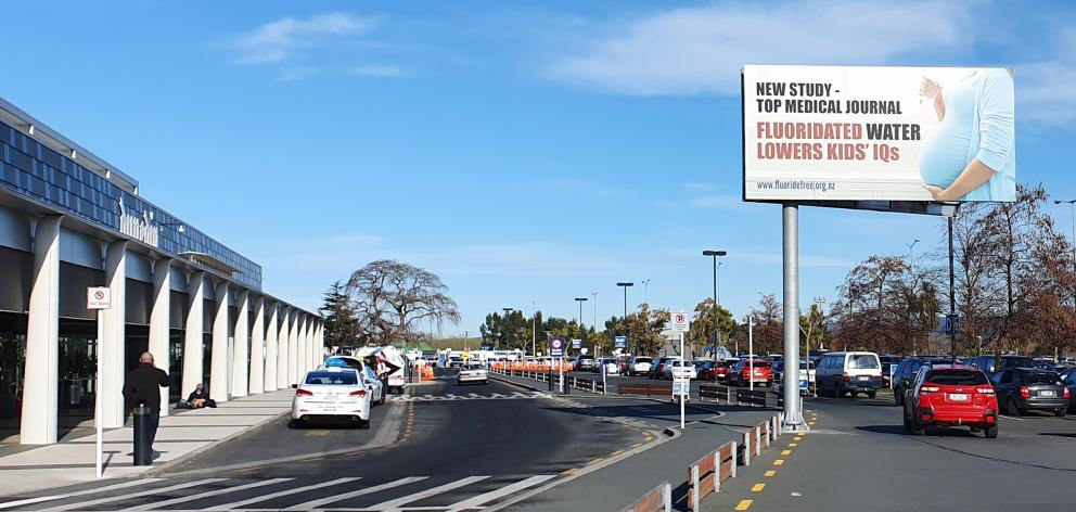 A Fluoride Free NZ billboard outside Dunedin Airport on Sunday, and being removed yesterday....