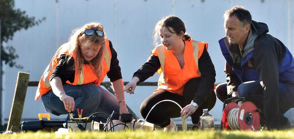 University of Otago lecturer Sarah Mager (left), masters student Sarah Yeo and GNS Science structural geologist Simon Cox test the water beneath South Dunedin. Photo: Peter McIntosh