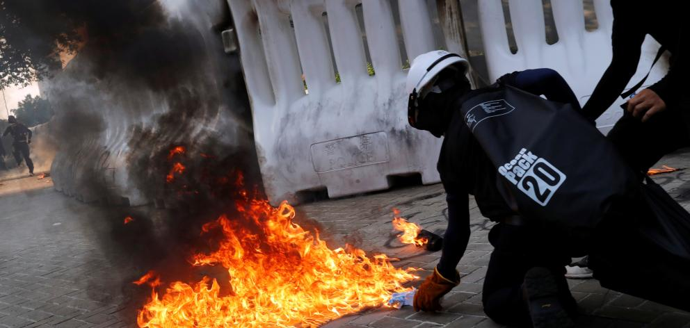 An anti-government protester prepares to throw a Molotov cocktail during a demonstration near...