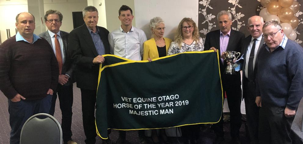 Awards officials are joined by supporters of Majestic Man, who was crowned Otago horse of the...