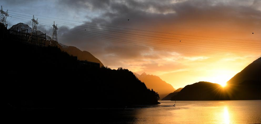 Transmission lines span West Arm at sunrise. PHOTOS: STEPHEN JAQUIERY