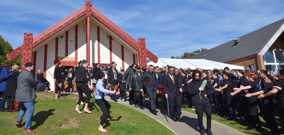 A haka and waiata are performed as a procession carrying former Ngai Tahu chief executive Tahu...