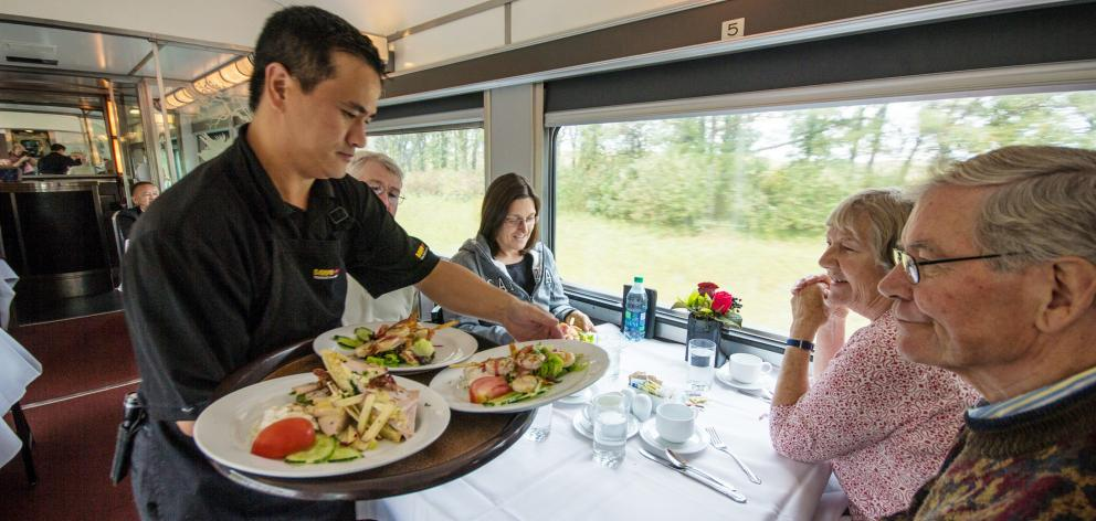 Food being served in the dining car.