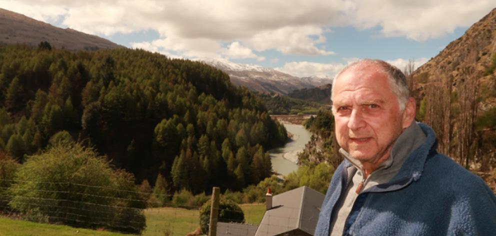 Concerned ratepayer Tom Dery opposite a proposed hillside subdivision above the Shotover River. Photo: Mountain Scene