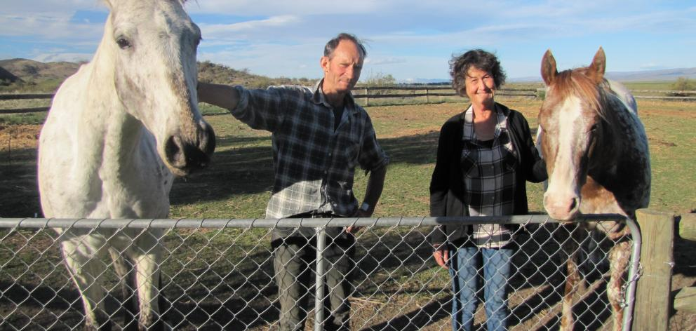 Richard and Jacqui Parsons, of Waikerikeri, relax with their muchloved horses Joey (left) and Reddog. PHOTO: PAM JONES