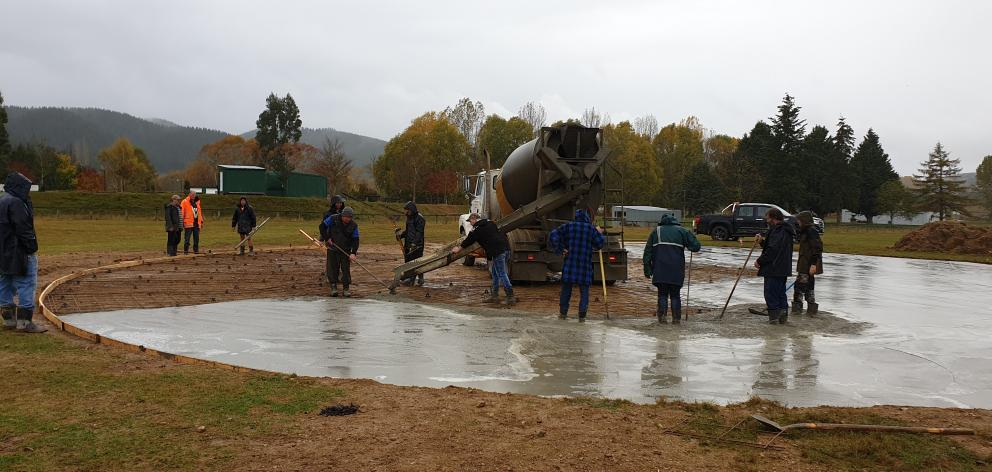 Lawrence Car Club members build a new burn-out pad in Wetherstons Gully last month. The pad will...