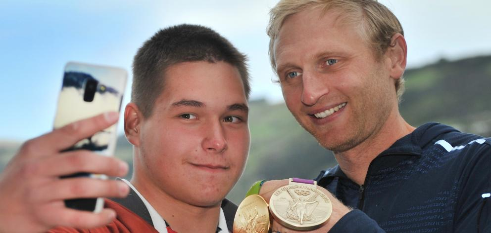 St Petersburg State University rower Egor Lubskii takes a selfie with Hamish Bond at the University of Otago's 150th anniversary international rowing regatta opening ceremony yesterday. Photos: Christine O'Connor