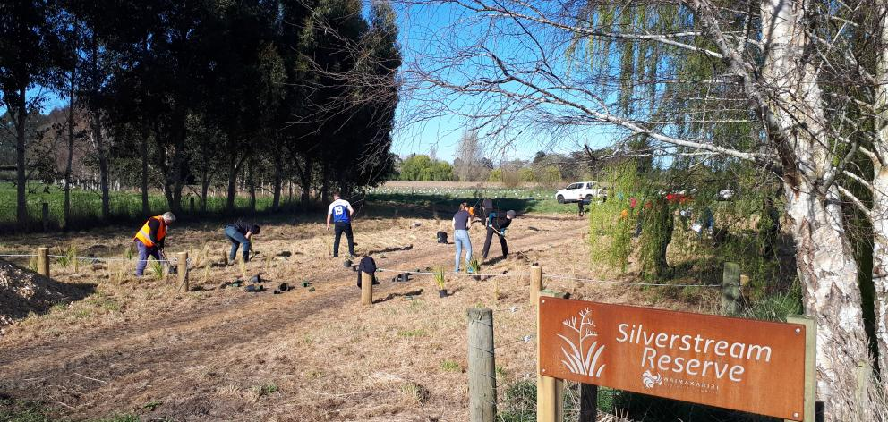 Fulton Hogan staff joined volunteers for a recent planting day at Silverstream Reserve. Photo: Supplied