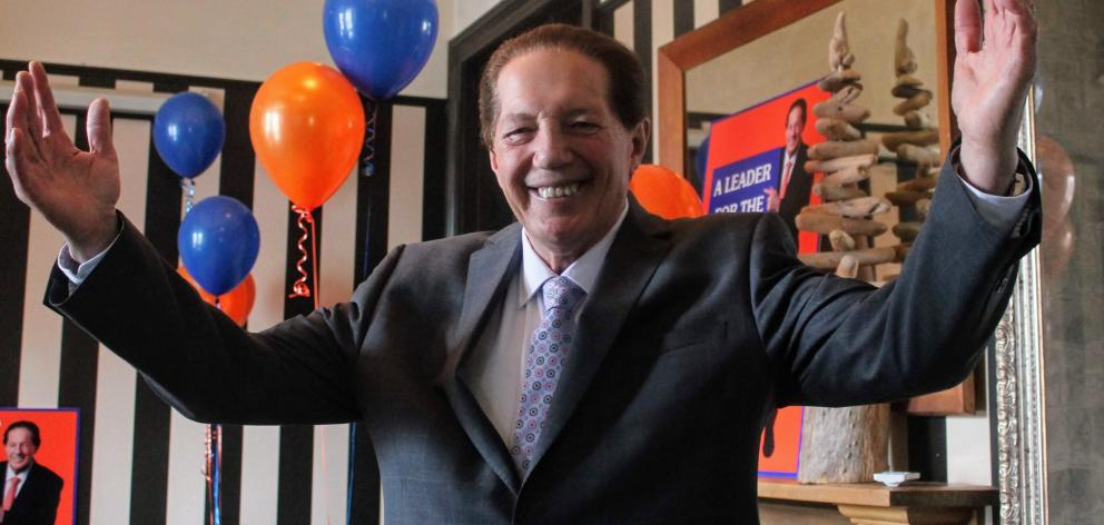 Hands to the sky, Sir Tim Shadbolt celebrated his mayoral re-election with friends and family on...