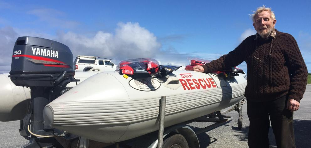 Max Dowell with the rescue boat. Photo: Greymouth Star