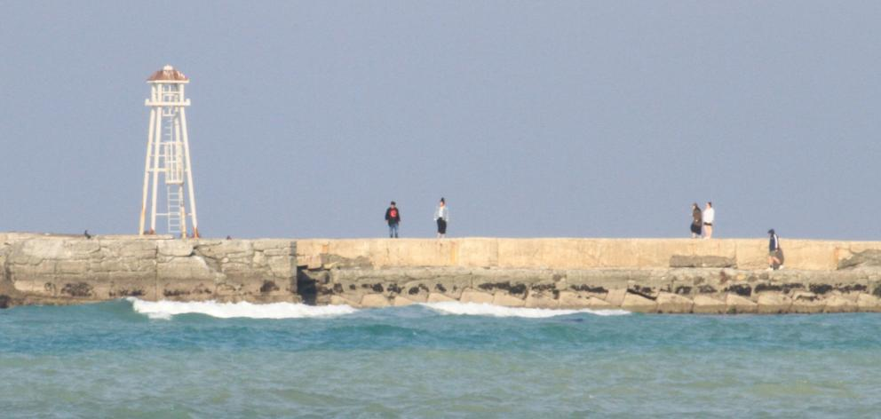 On a fine day, people regularly walk on the breakwater at Oamaru Harbour. Those who access the...