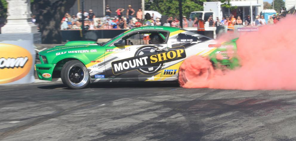 Drift specialist Shane Allen's 2008 Ford Mustang throws a bit of colour up at last year's Waimate 50. Photo: Hamish MacLean