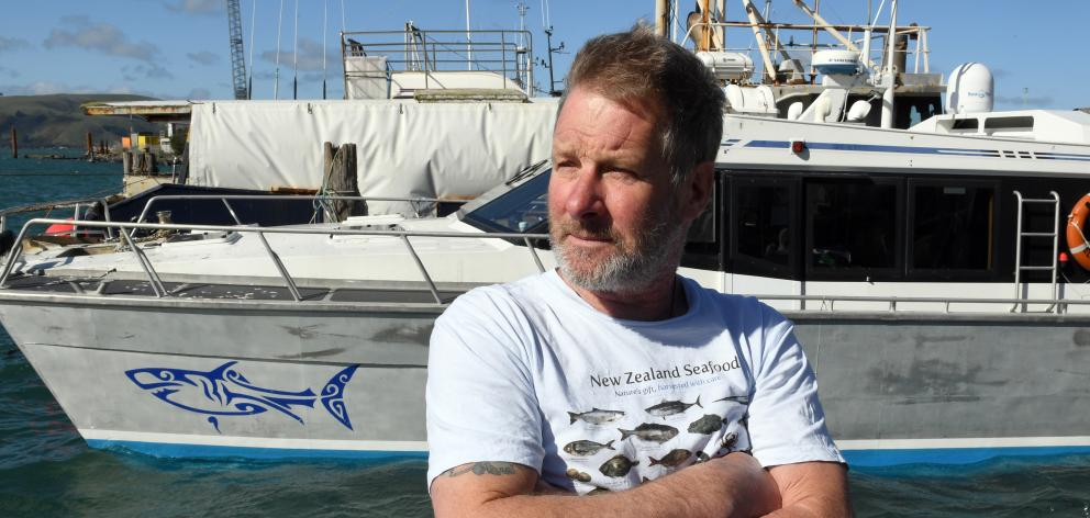 Backed by his shark cage diving vessel Fierce Elegance at Careys Bay yesterday, Shark Dive NZ...