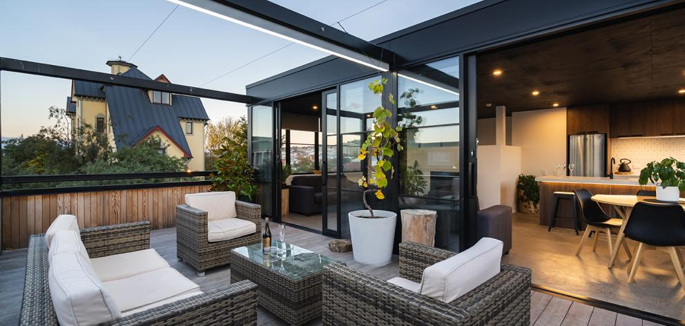 The outdoor area of an apartment in the building.