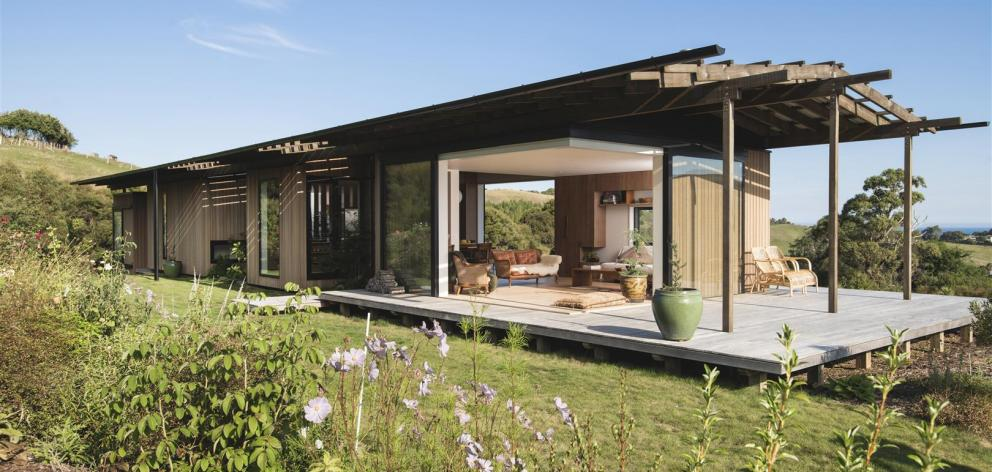 This Japanese-inspired two-bedroom home in Gisborne, designed by Andrew Simpson, of Wiredog...