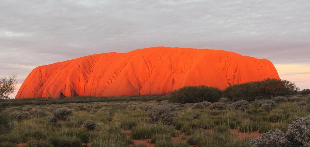 The bright orange hue of Uluru at sunset. Photo: Kerrie Waterworth