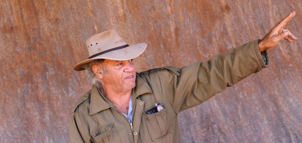Traditional owner Vincent Forrester guiding around the base of Uluru. Photo: Kerrie Waterworth