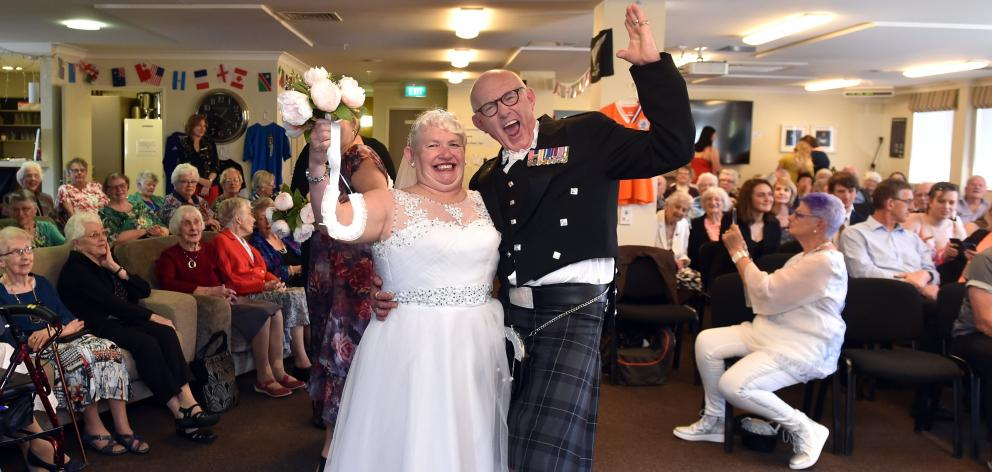 Anita and Neil Stockhall cannot contain their happiness after their wedding at a retirement...