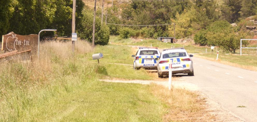 Two police cars parked up outside Toi Toi Orchards, near Alexandra, yesterday. PHOTO: ADAM BURNS