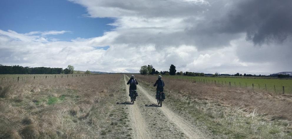 Cyclists travel on electric bikes along the Otago Central Rail Trail this Spring. E-bike use on...