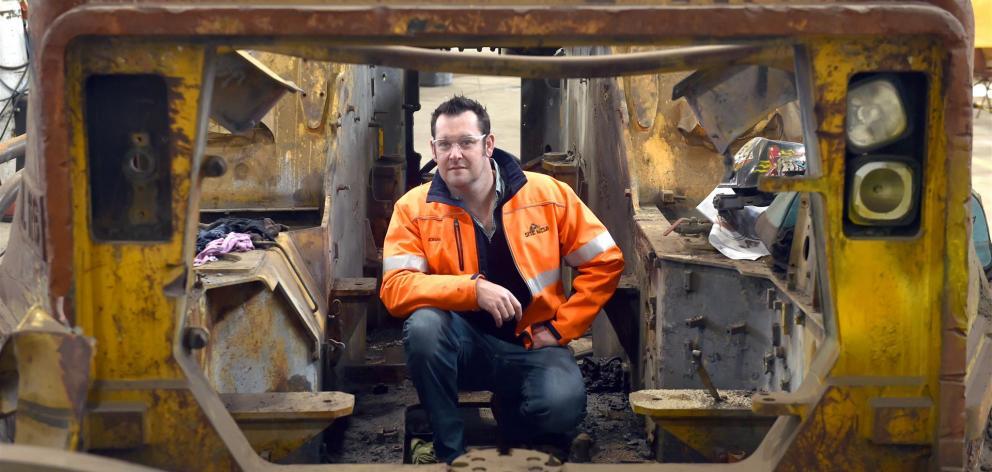 Site Weld founder Adrian Olsen in a Cat R1700 underground loader being refurbished for sale...