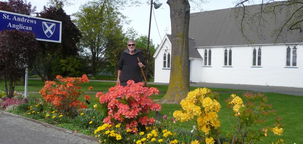 Volunteer gardener Cyril Keen at St Andrew's Church.