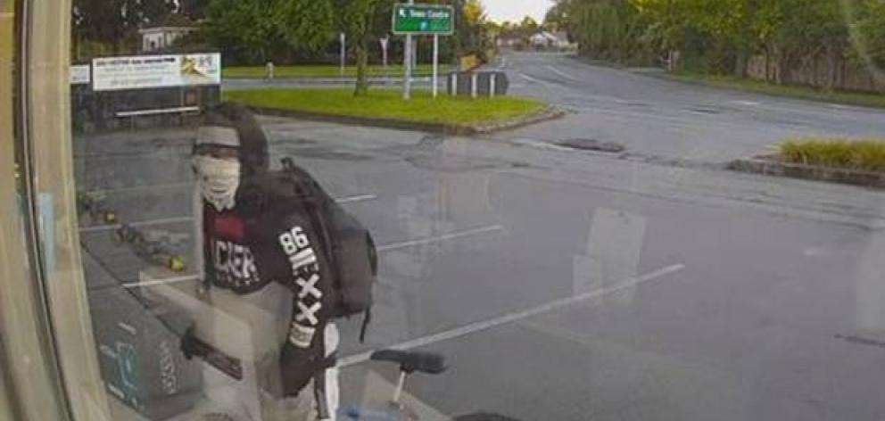 The 28-year-old man was seen approaching the store wearing a hoodie and a face mask. Photo: CCTV