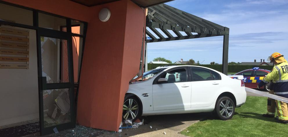 Two cars crashed and one ended up hitting the entrance of a medical practice in Invercargill today. Photo: Luisa Girao