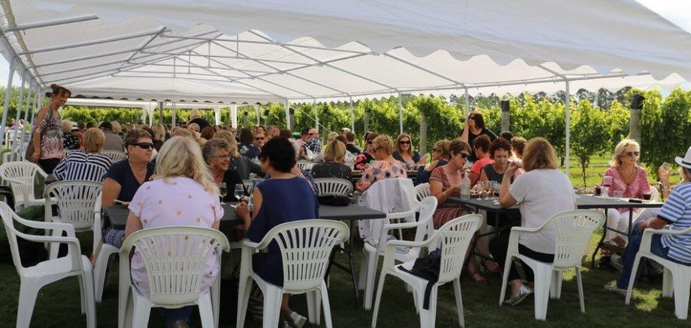 The CharRees Vineyard regularly hosts events such as Twilight in the Vines (pictured), with food, wine and music to entertain. Photo: Supplied