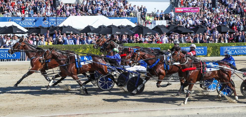 Cruz Bromac and driver Blair Orange beat Spankem and Mark Purdon to win the New Zealand Cup yesterday. Photo: Race Images