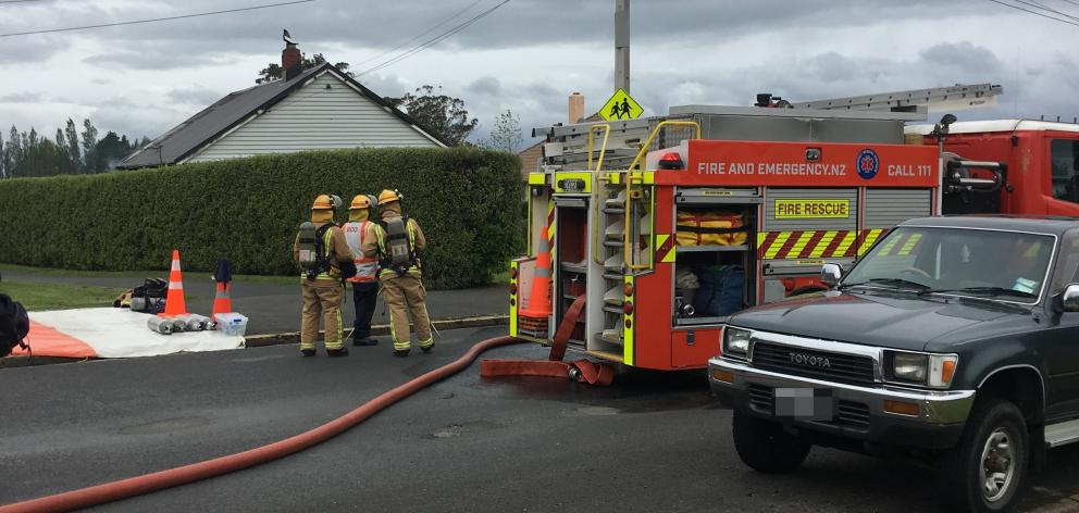 Emergency services at the scene of the fire at a house in Ashmore St. Photo: Emma Perry