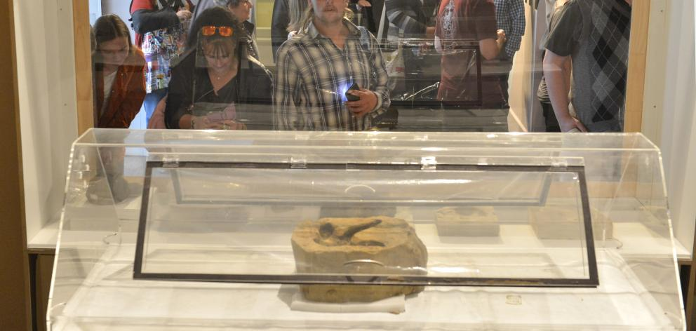 Viewing the moa feet on display at the Otago Museum are mother and son, Carolyn and Michael Johnston, of Ranfurly. Photo: Gerard O'Brien